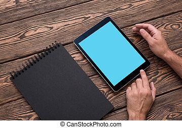 Man using app with digital tablet