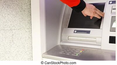Man Using ATM Machine
