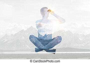 Man using binoculars on abstract snowy mountains background. Double exposure