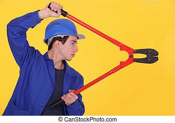 Man using bolt cutters