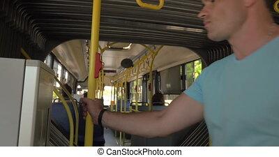 Man using bus ticket machine