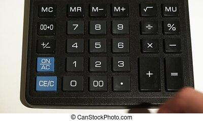 Man using calculator closeup on white background