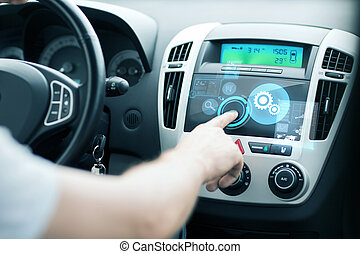 man using car control panel - transportation and vehicle...