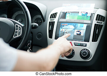 man using car control panel to read news - transportation...