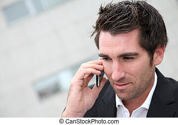 Man using cellphone in town
