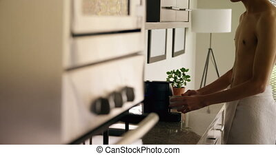 Man using coffee maker machine at home 4k - Young man using ...