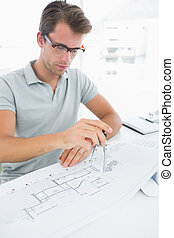 Man using compass on design
