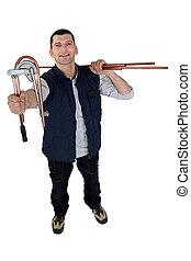 Man using copper pipe bending tool
