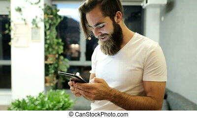 Man using digital tablet at home 4k - Happy man using...