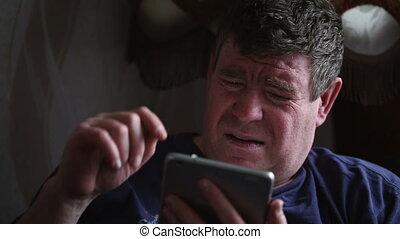 Man using digital tablet computer.