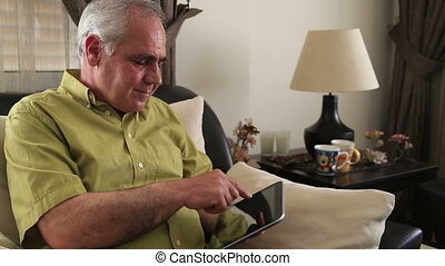 Man using digital tablet
