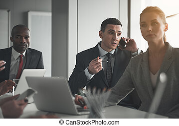 Man using gadget during meeting