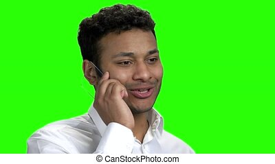Man using glass phone on green screen. Close up excited...