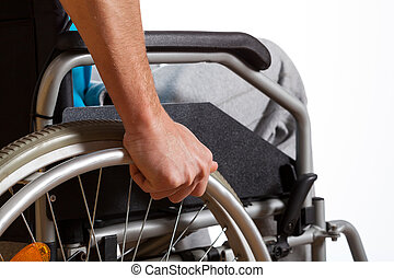 Man using his wheelchair - Disabled young man using his new...