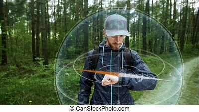 Man Using Hologram Compass - Young traveler man with...