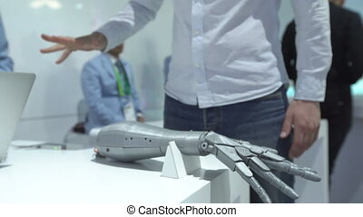 Man using innovative cybernetic arm system with motoin tracking on Expo
