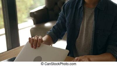Man using laptop at home 4k