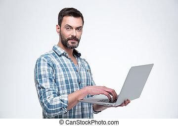 Man using laptop computer and looking at camera