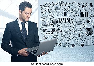 Man using laptop in room