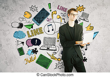 Man using laptop with social media icons
