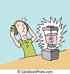 Man using loud blender