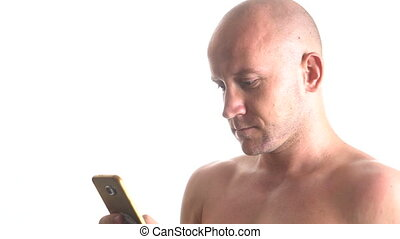 Man using mobile phone - Closeup portrait of young handsome...
