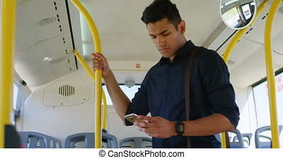 Man using mobile phone in the bus 4k - Handsome man using...