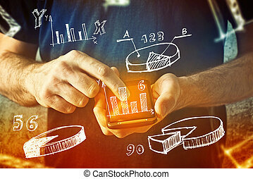 man using mobile phone with drawings of charts and other infographics in note pad. Close up image with selective focus. Business situation.
