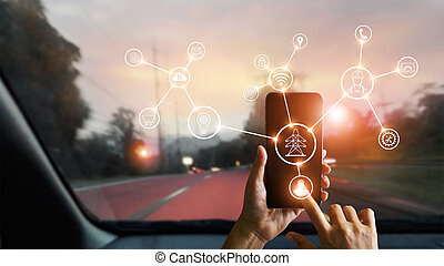 Man using mobile smartphone with icon, device processing network connection and communication in car on street on sunset background. Technology and telecommunication concept.