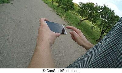 Man using navigation app on the mobile phone - Man using...