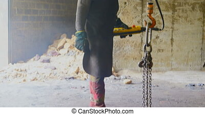 Man using overhead crane in foundry workshop 4k - Man using ...