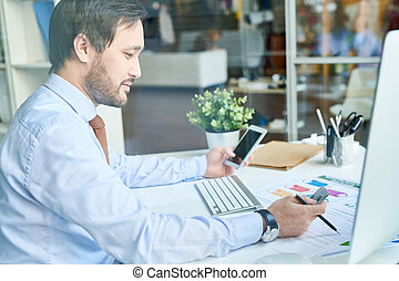 Man using phone and credit card