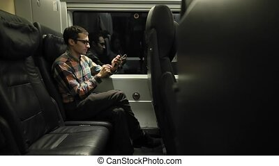 Man Using Phone in The Train