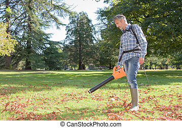 Man using portable leaf blower
