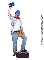 Man using power sander