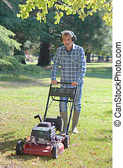 Man using push mower
