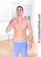 man using razor for shaving his beard and face