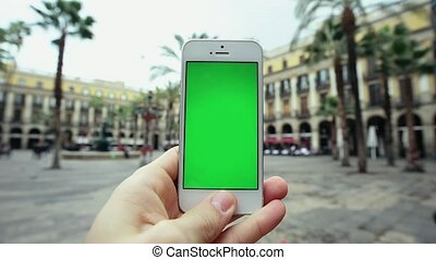 Man Using Smart Green Screen Phone Outdoors