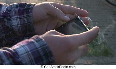 Man using smartphone and smoking