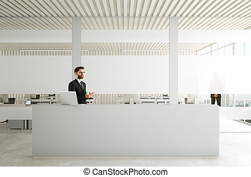 Man using smartphone at reception
