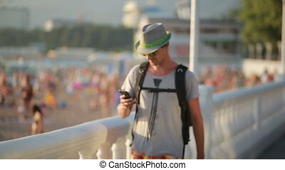 man using smartphone by the sea. photographed on a phone