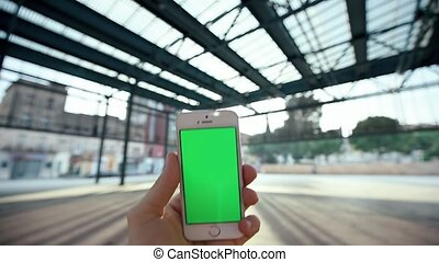 Man Using Smartphone Under Metal Canopy Sunny Day