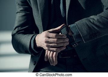 Man using smartwatch