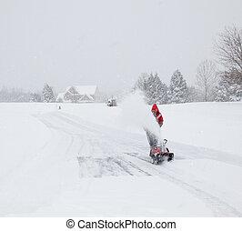 Man using snow blower on snowy drive - Senior man in red ...