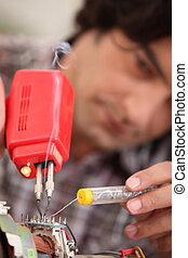 Man using soldering iron