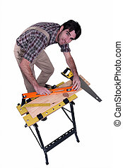 Man using spirit-level on laminate flooring