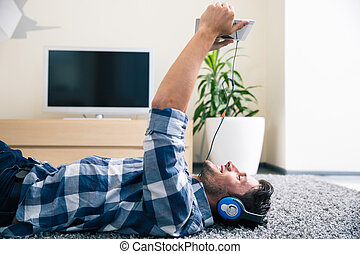 Man using tablet computer with headphones