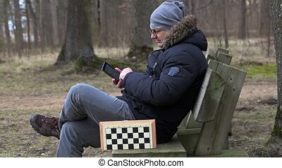 Man using tablet PC in the park
