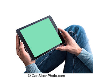 Man using tablet pc while sitting on a floor. Clipping path for display