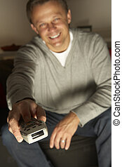Man Using Television Remote Control